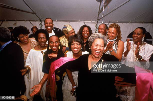 Nobel laureate Toni Morrison accepting the applause of partygoers Susan Taylor, Rita Dove, Oprah Winfrey, Angela Davis, Maya Angelou & others;...