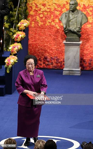 Nobel Medicine Prize 2015 cowinner Chinese Youyou Tu poses with her medal during the 2015 Nobel prize award ceremony at the Stockholm Concert Hall on...