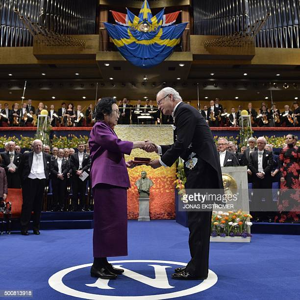 Nobel Medicine Prize 2015 cowinner Chinese Youyou Tu receives his medal from King of Sweden Carl XVI Gustaf during the 2015 Nobel prize award...