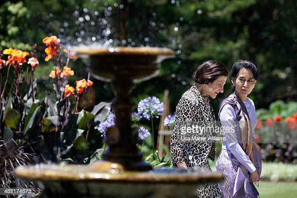 Nobel Peace Laureate and Myanmar opposition leader Aung San Suu Kyi walks with NSW Governor Marie Bashir in the gardens of Government House on...