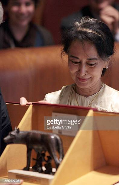 Nobel Peace Laureate Aung San Suu Kyi receives the honorary citizenship of Rome from Mayor Ignazio Marino in Campidoglio on October 27 2013 in Rome...