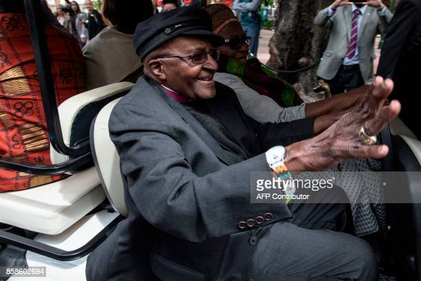 Nobel Peace Prize laureate and South African icon Archbishop Desmond Tutu waves as he leaves after attending the unveiling ceremony of the 'Arch for...