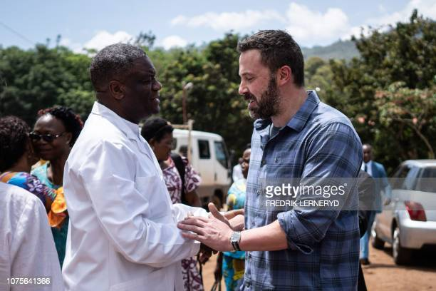 Nobel Peace Prize laureate Doctor Denis Mukwege shakes hands with US Actor Ben Affleck as he prepares to leave following a meeting at the Panzi...