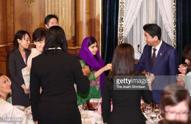 Nobel Peace Prize laureate Malala Yousafzai and Japanese Prime Minister Shinzo Abe toast glasses during the dinner inviting attendees of the WAW!...