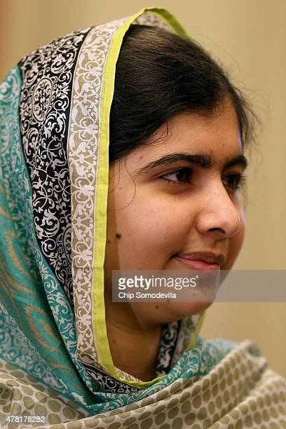 Nobel Peace Prize Laureate Malala Yousafzai poses for photographs before a meeting with Senate Minority Whip Richard Durbin about the importance of...