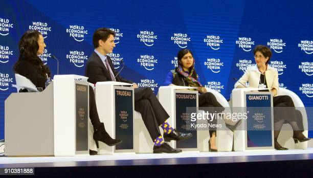 Nobel Peace Prize laureate Malala Yousafzai speaks alongside Canadian Prime Minister Justin Trudeau at a discussion at the World Economic Forum in...