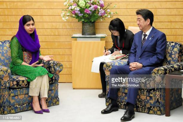 Nobel Peace Prize laureate Malala Yousafzai talks with Japanese Prime Minister Shinzo Abe during their meeting at the prime minister's official...