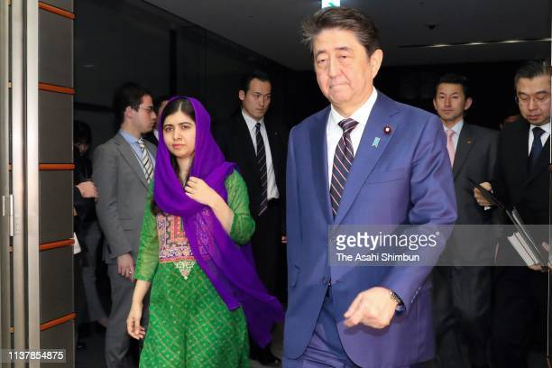 Nobel Peace Prize laureate Malala Yousafzai walks to attend a joint press conference with Japanese Prime Minister Shinzo Abe at the prime minister's...
