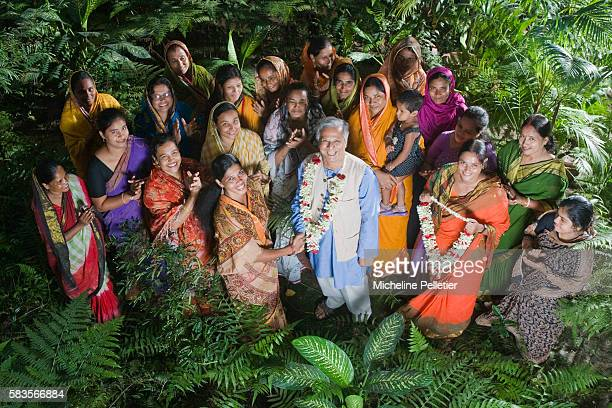 Nobel Peace Prize laureate Muhammad Yunus with the women of the villages he has helped Muhammad Yunus banker and economist is the founder and...
