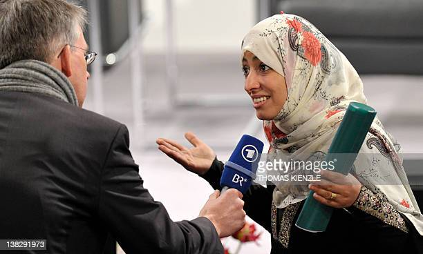 Nobel Peace Prize Laureate Tawakkul Karman gestures as she gives an interview during the 48th Munich Security Conference at the Bayerischer Hof hotel...
