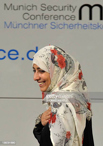 Nobel Peace Prize Laureate Tawakkul Karman smiles as she enters the stage for delivering her speech at the 48th Munich Security Conference at the...