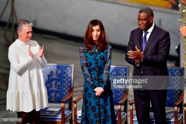 Nobel Peace Prize laureate Yazidi activist Nadia Murad is applauded by Chairman of the Norwegian Nobel Committee Berit ReissAndersen and Nobel Peace...