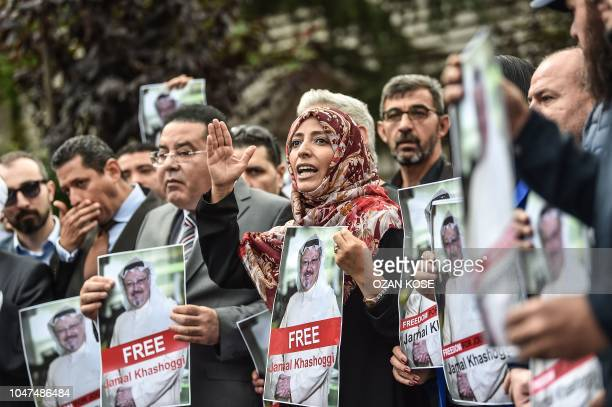 TOPSHOT Nobel Peace Prize laureate Yemeni Tawakkol Karman flanked by Egyptian opposition politican Ayman Nour holds pictures of missing journalist...