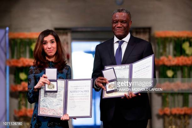 Nobel Peace Prize laureates Yazidi activist Nadia Murad and Congolese doctor Denis Mukwege pose with their Nobel Peace Prizes during the award...