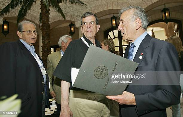 Nobel Peace Prize Winner Elie Wiesel chats with Joseph Ciechanover and Nobel Prize winner of Chemistry Aaron Ciechanover during the Nobel Laureates...