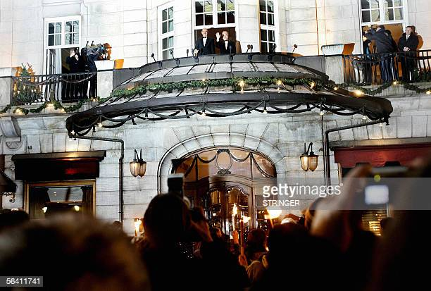 Nobel Peace Prize winner Mohamed ElBaradei , director general of the International Atomic Energy Agency , waves from the balcony of his hotel...