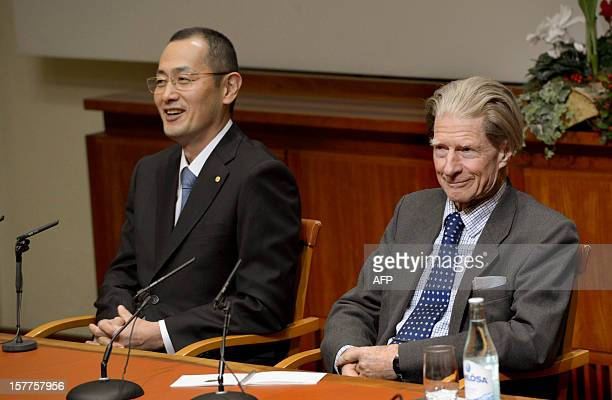 Nobel Physics laureates Shinya Yamanaka of Japan and John B Gurdon of England attend a news conference on December 6 2012 at the Karolinska Institut...