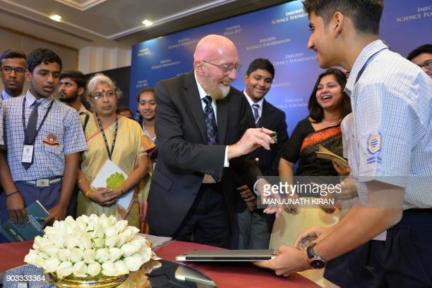 Nobel Prize 2017 Laureate in Theoretical Physics Prof Kip Thorne signs autographs for students after an interaction prior the Infosys Prize 2017 in...