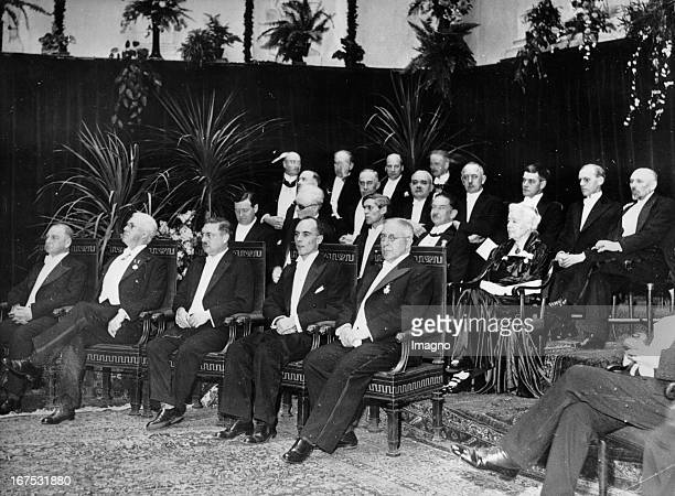 Nobel Prize ceremonies in Stockholm Left to right Otto Loewi Henry Hallett Dale Peter Debye Carl David Anderson Victor Franz Hess Second row Prof...