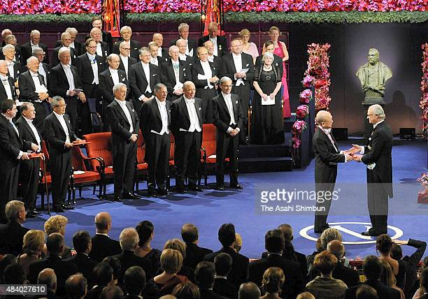 Nobel Prize in Chemistry laureate Akira Suzuki receives the medal from the King Carl XVI Gustaf of Sweden during the Nobel Prize Award Ceremony at...