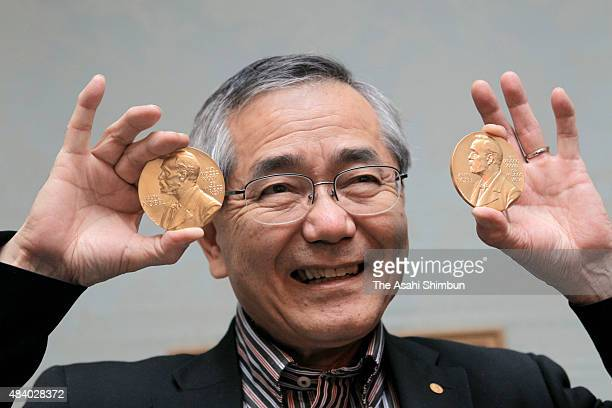 Nobel Prize in Chemistry laureate Eiichi Eguchi poses for photographs with the Nobel Prize medal during a press conference on December 13 2010 in...