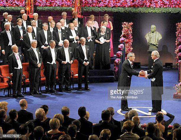 Nobel Prize in Chemistry laureate Eiichi Negishi receives the medal from the King Carl XVI Gustaf of Sweden during the Nobel Prize Award Ceremony at...