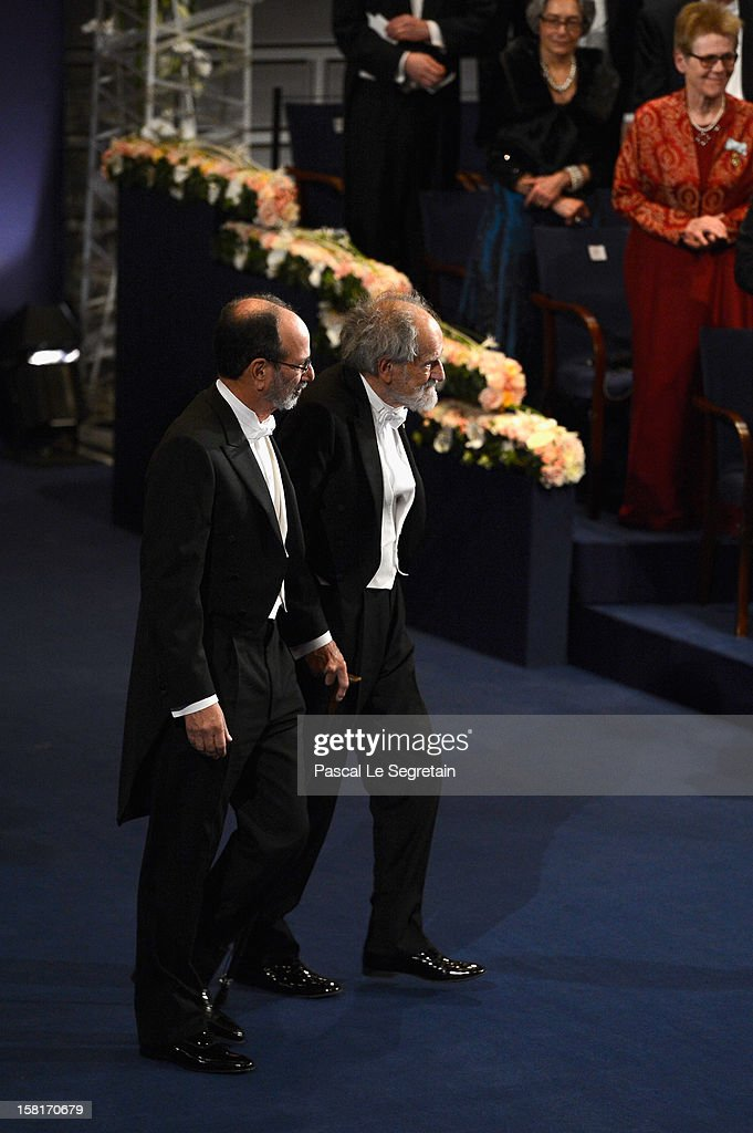 Nobel Prize in Economic Sciences laureates Professor Alvin E. Roth of the USA (L) and Professor Emeritus Lloyd S. Shapley of the USA (R) prepare to receive their Nobel Prize from King Carl XVI Gustaf of Sweden during the Nobel Prize Ceremony at Concert Hall on December 10, 2012 in Stockholm, Sweden.
