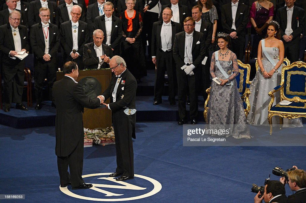 Nobel Prize in Literature laureate, author Mo Yan of China (L) receives his Nobel Prize from King Carl XVI Gustaf of Sweden (2nd L) as Queen Silvia of Sweden (2nd R) and Princess Madeleine of Sweden (R)during the Nobel Prize Ceremony at Concert Hall on December 10, 2012 in Stockholm, Sweden.