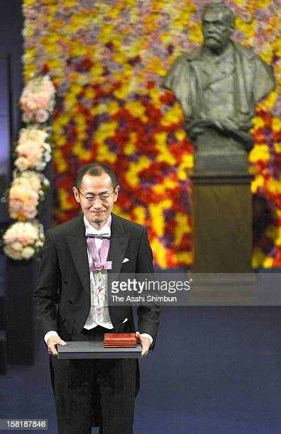 Nobel Prize in Medicine laureate Shinya Yamanaka smiles after he received the Nobel Prize from King Carl XVI Gustaf of Sweden during the Nobel Prize...