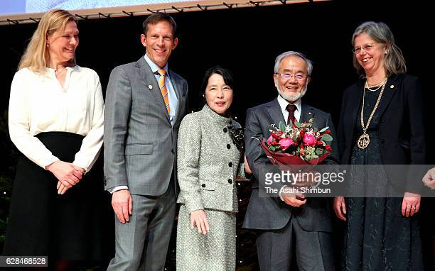 Nobel Prize in Medicine laureate Yoshinori Ohsumi and his wife Mariko pose for photographs during a press conference at the Karolinska Institute on...