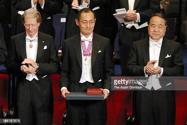 Nobel Prize in Medicine laureates Sir John Gurdon Shinya Yamanaka and Nobel Prize in Literature Mo Yan attend the Nobel Prize Award Ceremony at...