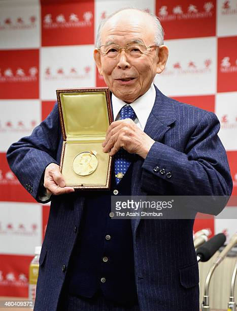 Nobel Prize in Physics laureate Isamu Akasaki poses with the Nobel Prize medal during a press conference upon arrival at Tokyo International Airport...