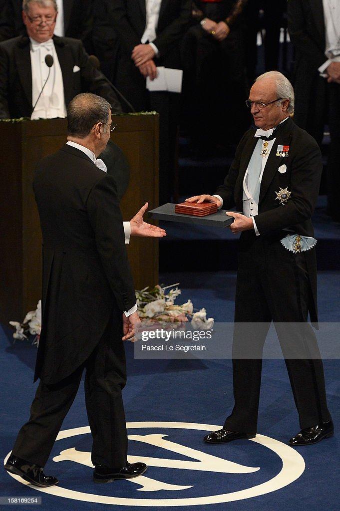 Nobel Prize in Physics laureate Professor Serge Haroche of France (L) receives his Nobel Prize from King Carl XVI Gustaf of Sweden during the Nobel Prize Ceremony at Concert Hall on December 10, 2012 in Stockholm, Sweden.