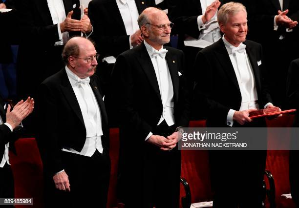 Nobel Prize in Physiology or Medicine 2017 laureates Jeffrey C Hall Michael Rosbash and Michael W Young acknowledge applause during the Nobel award...