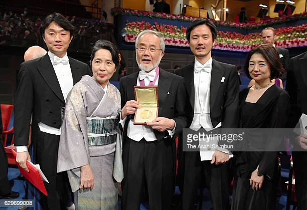 Nobel Prize in Physiology or Medicine laureate Yoshinori Ohsumi and his wife Mariko pose for photographs after the Nobel Prize Awards Ceremony at...