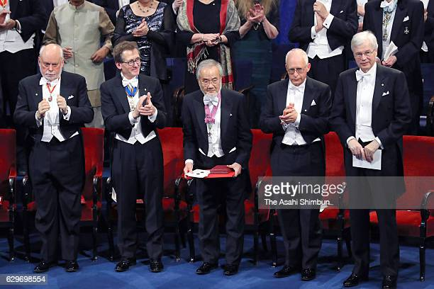 Nobel Prize in Physiology or Medicine laureate Yoshinori Ohsumi acknowledges after receiving his Nobel Prize from King Carl XVI Gustaf of Sweden...