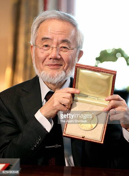 Nobel Prize in Physiology or Medicine Yoshinori Ohsumi shows his medal and certificate on December 12 2016 in Stockholm Sweden