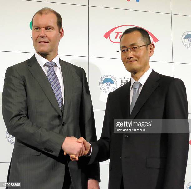 Nobel Prize laureate and Kyoto University's Center for iPS Cell Research and Application director Shinya Yamanaka shakes hands with Takeda...
