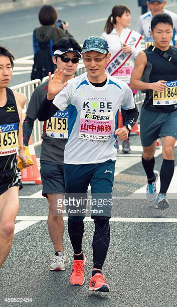 Nobel prize laureate and scientist Shinya Yamanaka takes part in the Kobe Marathon 2014 on November 23 2014 in Kobe Hyogo Japan
