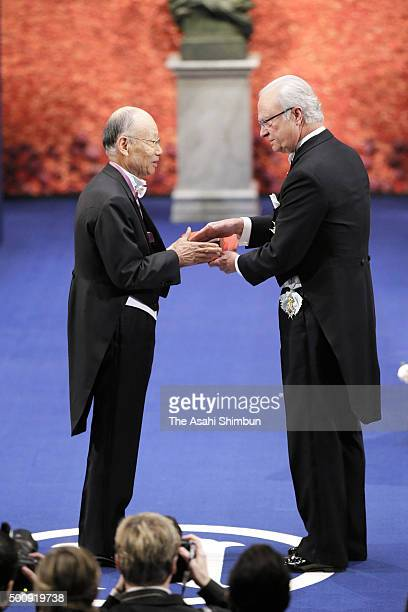 Nobel Prize laureate in Physiology or Medicine Satoshi Omura receives the medal from King Carl XVI Gustaf of Sweden during the Nobel Prize Awards...