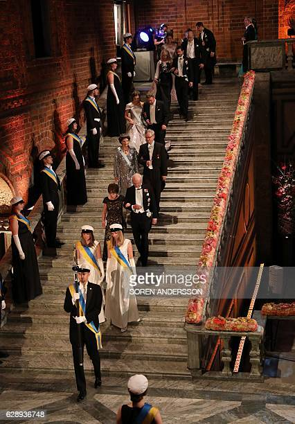 Nobel prize laureates and the Swedish royal family arrive for the 2016 Nobel Banquet for the laureates in medicine chemistry physics literature and...