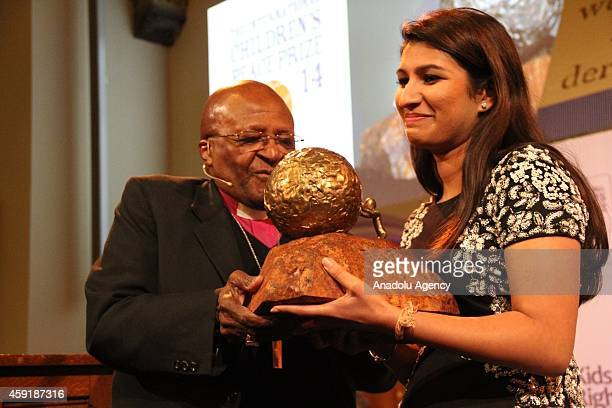 Nobel Prize owner Desmond Tutu and American Neha Gupta received this year's prize poses during the ceremony for the 10th International Childrens...