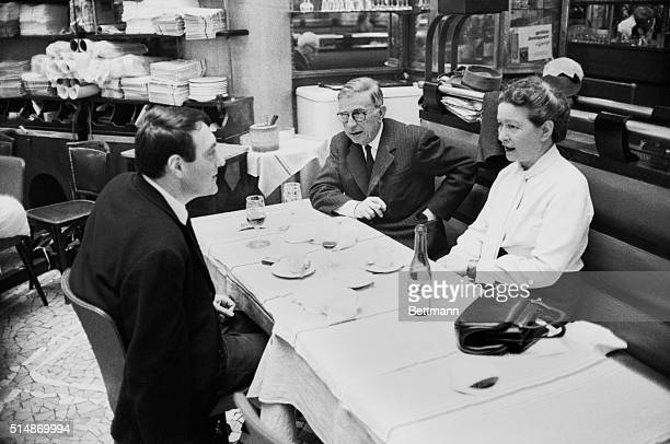 Nobel Prize winner and existentialist author JeanPaul Sartre dining in a Paris restaurant with writer and philosopher Simone de Beauvoir and...