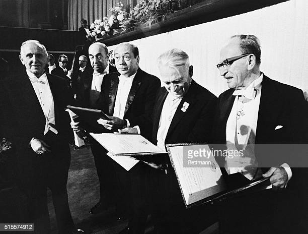 Nobel prize winners Pablo Neruda, Denis Gabor, Dr. Gerhard Herzberg, Dr. Simon Kuznets, and Dr. Earl Sutherland hold their awards after the ceremony...