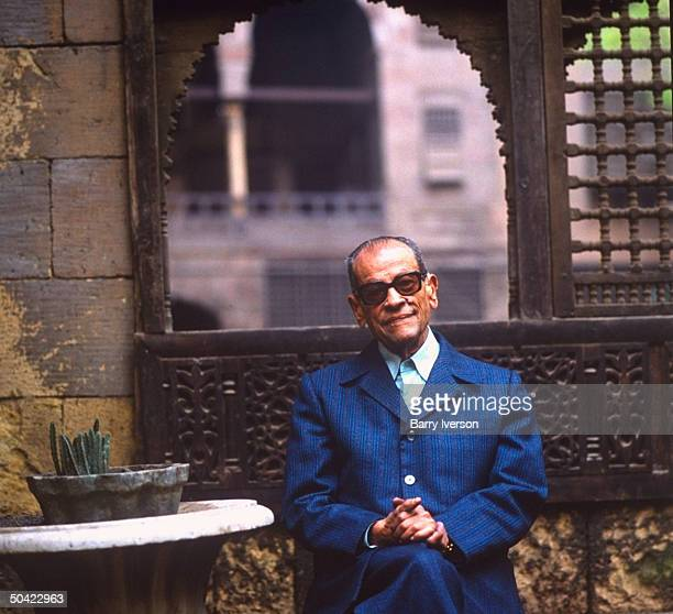 Nobel Prize winning author Naguib Mahfouz at old Arab courtyard home Beit alSuhaymi in Gamaliya quarter where he grew up