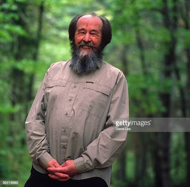 Nobel prizewinning author and critic of Soviet regimes Aleksandr Solzhenitsyn standing outside nr his home
