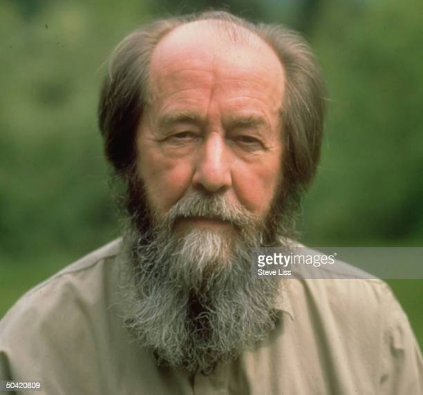 Nobel prizewinning author and critic of Soviet regimes Aleksandr Solzhenitsyn standing outside at his home