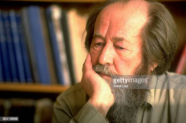 Nobel prizewinning author and critic of Soviet regimes Aleksandr Solzhenitsyn sitting w chin in hand at his home