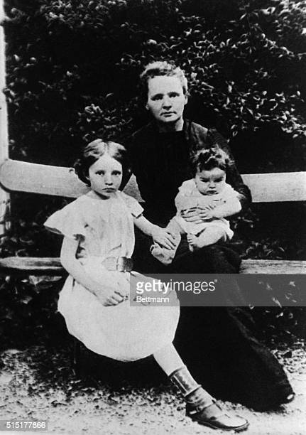 Nobel Prizewinning chemist Marie Curie poses with her daughters Irene and Eve