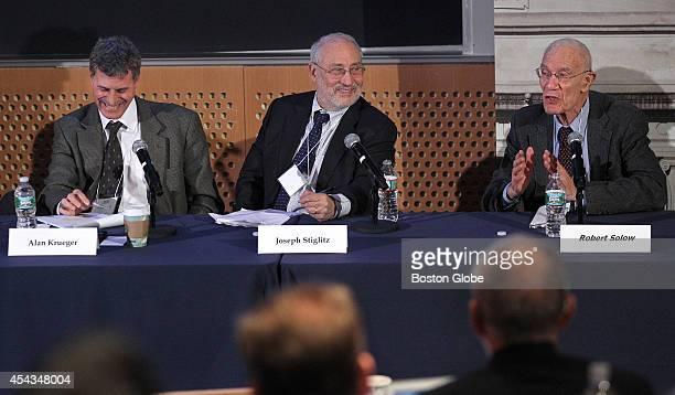 Nobel Prizewinning economist and Columbia University professor Joseph Stiglitz center sits on a panel with Alan Krueger left and Robert Solow MIT's...